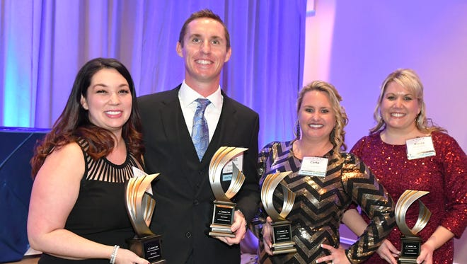 Left to right, Iris Graham, accepting the award for her husband Kyle Graham, who was out of town, joins Wyatt Hoover, Carla McRae and Krista Miller. LEAD Brevard's 2018 Leadership Awards were presented at the Holiday Inn Express & Space Coast Convention Center in Cocoa.