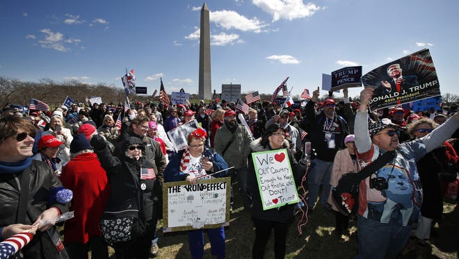 Supporters of President Donald Trump, cheer at the National Mall near the Washington Monument in Washington during a rally organized by the North Carolina-based group Gays for Trump, Saturday, March 4, 2017. The speakers at the rally talked about immigration, gay rights, and several outer issues and later marched from the National Mall to the White House. (AP Photo/Manuel Balce Ceneta)