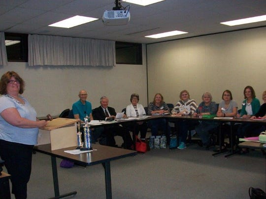 Toastmasters President Jenny Woosencraft presides over the Oct. 9 meeting of Fond du Lac Toastmasters Club No. 498.