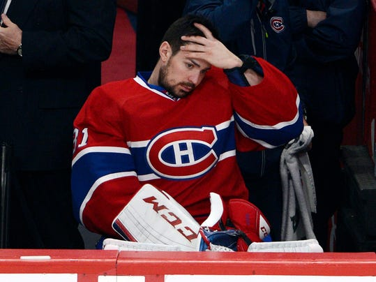 Montreal Canadiens goalie Carey Price (31) watches from the bench during the third period in Game 1 of the Eastern Conference finals in the NHL hockey Stanley Cup playoffs in Montreal on Saturday, May 17, 2014. The Rangers won 7-2. (AP Photo/The Canadian Press, Ryan Remiorz)