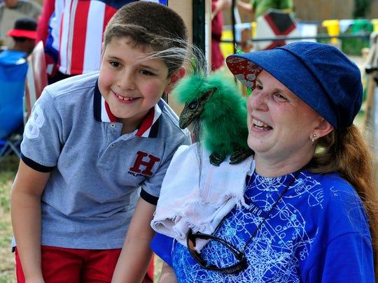 A.J. Cerda and his mom, Rachel Miller, participate in the 2015 Children's Fair.