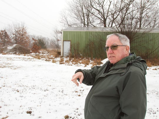 Putnam Township supervisor Dennis Brennan describes the proposed path of the ET Rover pipeline through township-owned land behind the township hall. Original plans would require the demolition of the storage shed behind Brennan; when Brennan conceded to that if Rover would build a new shed elsewhere, it was decided that the path could go around the existing shed.