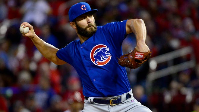 Cubs starting pitcher Jake Arrieta delivers a pitch against the Cardinals during their game at Busch Stadium.