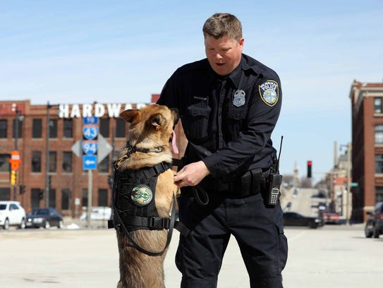 Milwaukee Police Officer Brian Brosseau is greeted