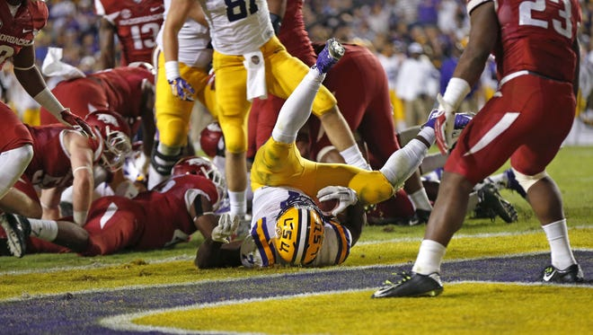 LSU running back Leonard Fournette (7) lands in the enzone on a rushing touchdown in the second half of an NCAA college football game against Arkansas in Baton Rouge, La., Saturday, Nov. 14, 2015. Arkansas won 31-14. (AP Photo/Gerald Herbert)