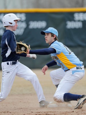 St. Mary Catholic shortstop Christian Jack takes a throw at first base against Xavier during a game earlier this season.