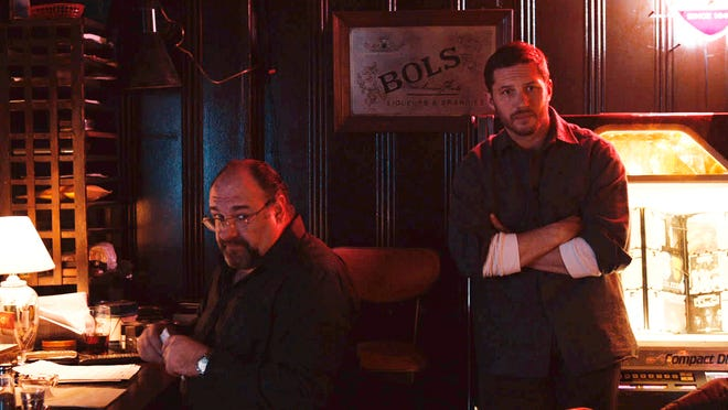 """James Gandolfini, left, as Cousin Marv, and Tom Hardy, as Bob, are shown in a scene from the film, """"The Drop."""""""