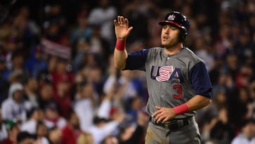 Tigers second baseman Ian Kinsler scores a run in the championship-game victory over Puerto Rico in the World Baseball Classic.