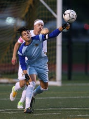 McQuaid goalkeeper Tommy Gallina clears the ball to