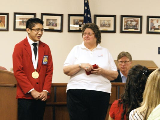 Ryan Larko is introduced by his teacher and Deming High School SkillsUSA Sponsor Mary Anderson during Thursday's meeting of the Deming Public Schools Board of Education.
