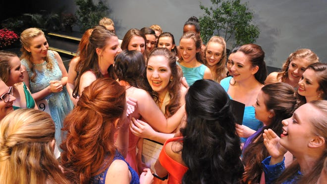 Emma Stoolmaker (center) from Dallastown Area High School hugs her fellow participants as she accepts the award for Distinguished Young Woman of York County on Saturday, May 6. The award comes with a $12,000 scholarship.
