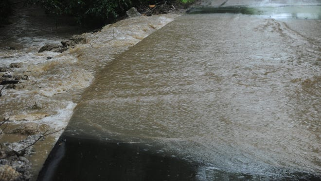 Motorists should watch for running water across roads and should not drive through the water.