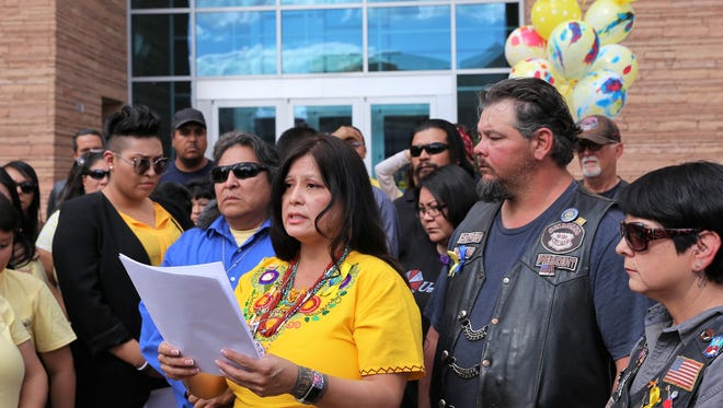 Pamela Foster, center, the mother of Ashlynne Mike, speaks outside the Pete V. Domenici United States Courthouse in Albuquerque on Friday as Ashlynne's father Gary Mike, left, listens.