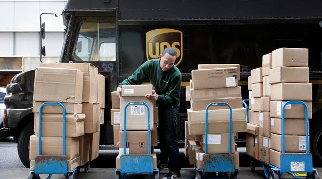 UPS is hiring 90,000 to 95,000 seasonal workers to keep up with the deluge of holiday package deliveries.