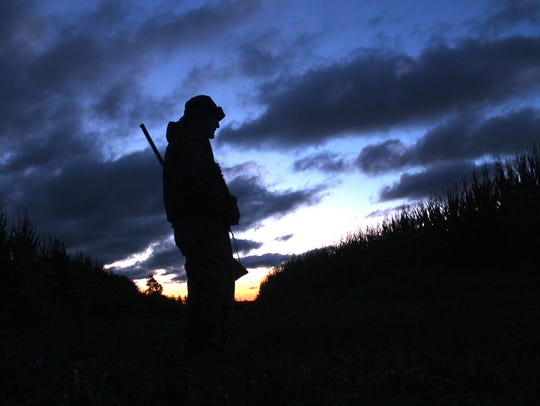 Jerry Solsrud of Oconomowoc watches the dawn sky on