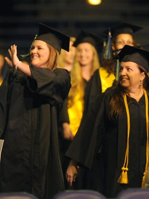 Students make their way into the Pensacola Bay Center Saturday during the University of West Florida Commencement ceremony.