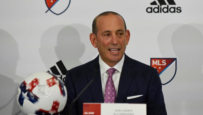 MLS commissioner Don Garber attends a news conference in Chicago.