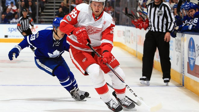 Red Wings forward Anthony Mantha is chased by the Maple Leafs' William Nylander Tuesday in Toronto.