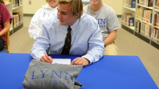 Stephen Decatur's Dryden Brous signs his national letter of intent to play lacrosse at Lynn University.