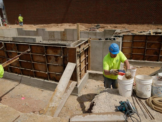 Ken Paluch of Miron Construction works on the foundation