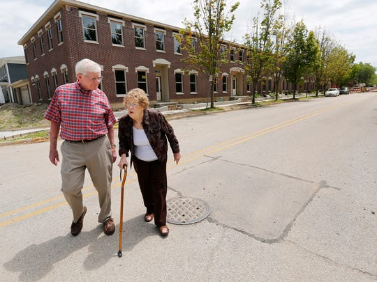 Michael and Phyllis Hunt walk back to their home after