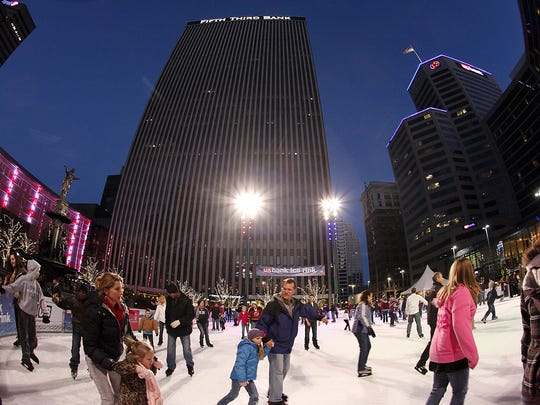 The ice skating rink on Fountain Square draws families,