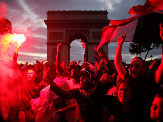 People celebrate on the Champs Elysees avenue, with