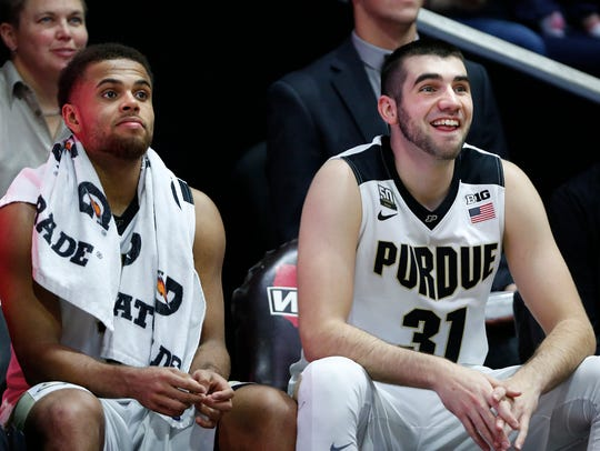 Dakota Mathias and P.J. Thompson of Purdue half a laugh
