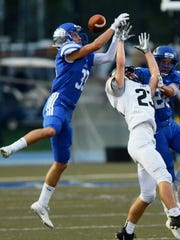 Lakeland's Luke Perry (left) goes up for the ball with