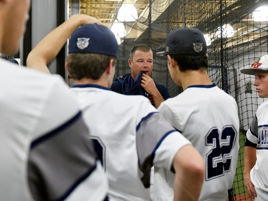 Dallastown head coach Greg Kinneman speaks to the team during a rain delay that postponed the PIAA Class 6A baseball title game Friday, June 16, 2017, at Medlar Field at Lubrano Park in State College. After a 3.5-hour rain delay and despite outhitting Pennsbury 7-4, Dallastown lost 1-0 in Pennsbury's walk-off win in the seventh inning.