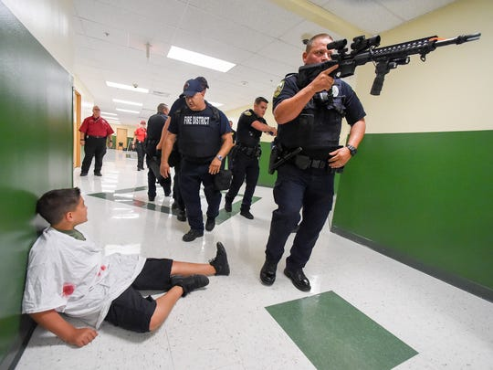 "Port St. Lucie Police Officers and St. Lucie County Fire Rescue conduct ""active threat"" and S.A.V.E. (Swift Assisted Victim Extraction) training Wednesday, July 11, 2018, at Renaissance Charter School of St. Lucie in Port St. Lucie."