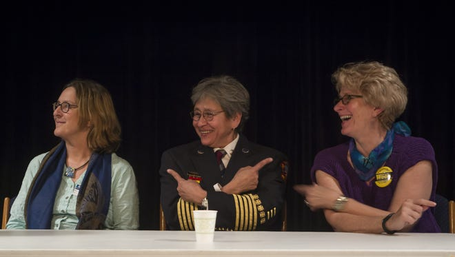 Guest speaker Debra Amesqua points to the Susan Cerulean (left) and Rosanne Wood (right) when asked to describe a phenomenal woman during a question and answer session segment of an event honoring Women's History Month at Sail High School.