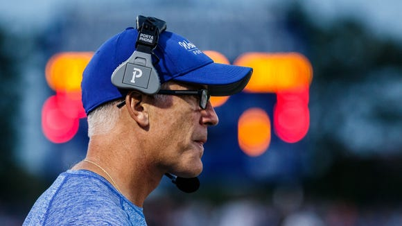 Waukesha West head coach Steve Rux follows the action during the game at home against Arrowhead on Friday, Sept 9, 2016.