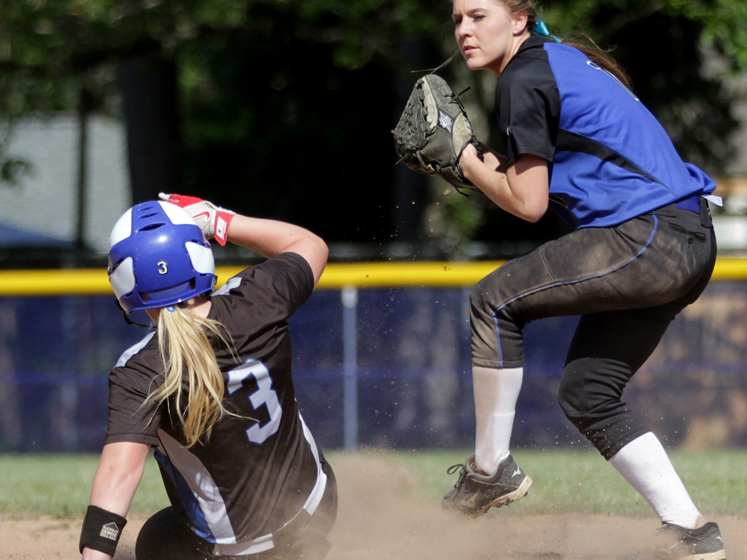 Gresham's Maddy Lindhorst (1) looks to pass to first after getting McNary's Madisen Oliver (3) out at second in the Gresham vs. McNary softball game, in the first round of the OSAA class 6A state playoffs, at McNary High School in Keizer on Monday, May 25, 2015. McNary won the game 11-7.