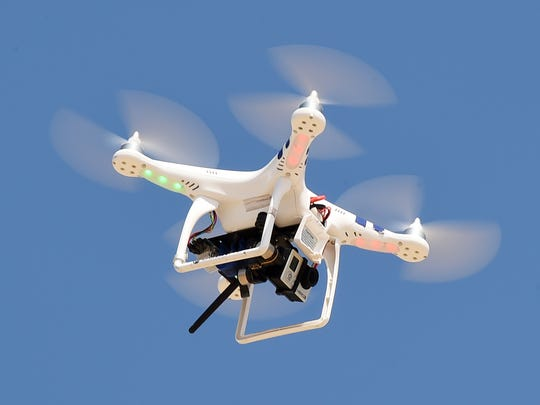 T.J. Redefer, a Dewey Beach real estate broker, flies one of his drones with a GoPro Hero3 camera on the beach in Dewey Beach.