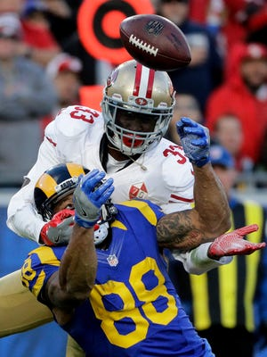 San Francisco 49ers cornerback Rashard Robinson, top, breaks up a pass intended for Los Angeles Rams tight end Lance Kendricks during the second half of an NFL football game, Saturday, Dec. 24, 2016, in Los Angeles. (AP Photo/Jae C. Hong)