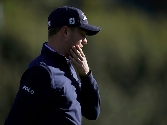 Justin Thomas reacts after making double bogey on the 13th hole during the final round of the Genesis Open golf tournament at Riviera Country Club on Sunday, Feb. 17, 2019, in the Pacific Palisades area of Los Angeles. (AP Photo/Ryan Kang)
