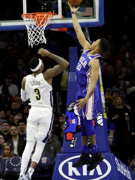 Philadelphia 76ers' Markelle Fultz (20) goes up for a shot against Denver Nuggets' Torrey Craig (3) during the first half of an NBA basketball game, Monday, March 26, 2018, in Philadelphia. (AP Photo/Matt Slocum)