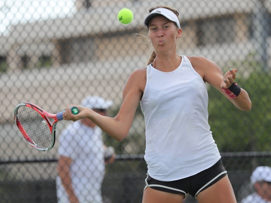 Viva Laas, the Sharks' No. 1, takes on an eye-high forehand in Gulf Coast's victory over Venice in the Class 3A-Region 6 Championship on Thursday, April 20, 2017, in Venice.