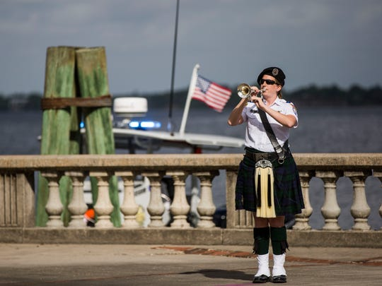 Naples resident Beth McElheran performs taps during a memorial for fallen police officers in Lee County at Centennial Park in Fort Myers on Thursday, May 18, 2017. McElheran was one of the first 500 to join Bugles Across America and plays taps at services throughout Southwest Florida.