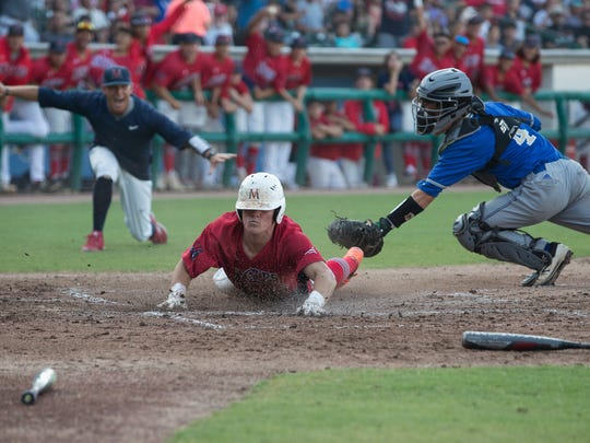 Veterans Memorial's Davis Horne slides home to score during the fourth inning of the the Class 5A regional against Tivy at Whataburger Field on Saturday, June. 2, 2018.