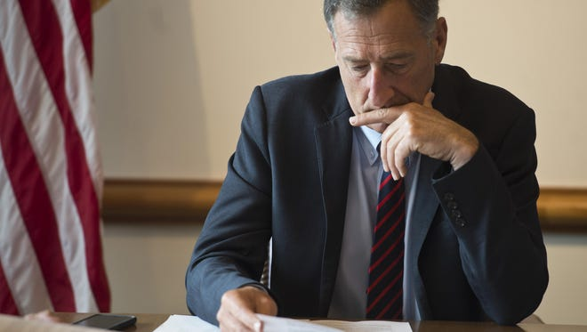 Gov. Peter Shumlin listens to an economic report during a budget meeting at his office in Montpelier Monday morning, July 27, 2015.