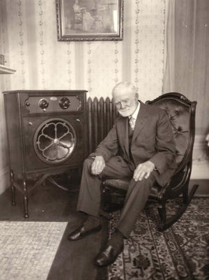 Charles Bradley bought one of the first radios in Rochester from Lothrops and Farnum in Dover. They took this picture of him in his living room and used it in an ad for their radios.