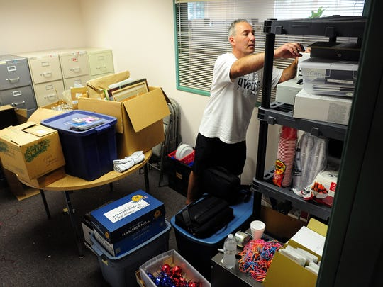 CASA volunteer Don Mason sorts items in a storage room as they move out of the Department of Human Services building Friday, May 29, in Salem.