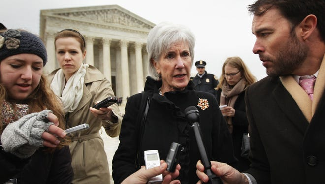 Former U.S. Secretary of Health and Human Services Kathleen Sebelius (C) speaks to members of the media as she comes out from the U.S. Supreme Court after oral arguments March 4, 2015 in Washington, DC. The Supreme Court was scheduled to hear oral arguments in the case of King v. Burwell that could determine the fate of health care subsidies for as many as eight million people.