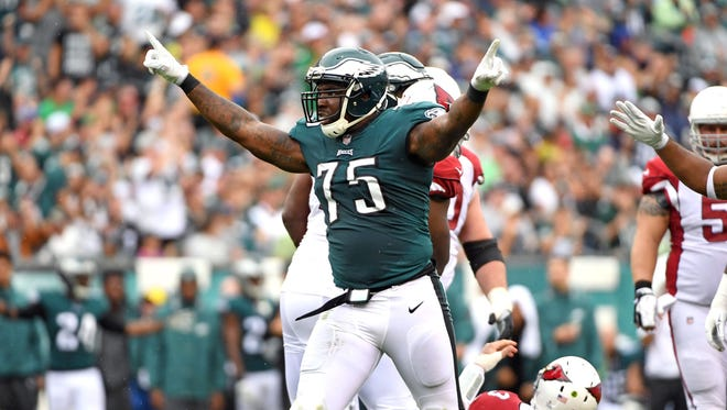 Philadelphia Eagles defensive end Vinny Curry (75) celebrates after sacking Arizona Cardinals quarterback Carson Palmer (3) during the second quarter at Lincoln Financial Field.