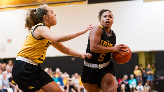 Iowa guard Alexis Sevillian goes for a shot while being covered by Iowa guard Kathleen Doyle during a women's basketball summer scrimmage on Friday, July 13, 2018, at Carver-Hawkeye Arena in Iowa City, Iowa.