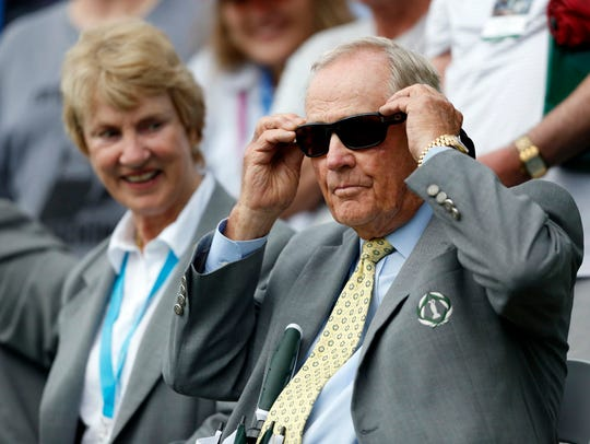 Jack Nicklaus and his wife, Barbara, watch on the 18th