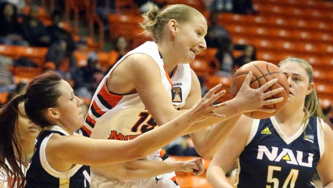 UTEP forward Agata Dobrowolska, 15, snags a rebound against Rene Coggins, left, and Alyssa Rader of Northern Arizona on Tuesday night in the Don Haskins Center.