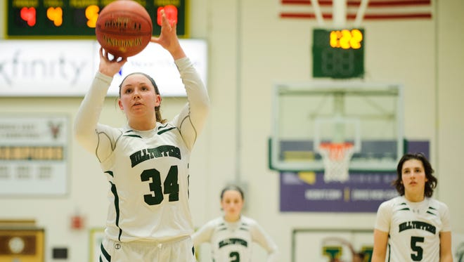 St. Johnsbury's Josie Choiniere (34) shoots a free throw during the Division I high school girls basketball championship between the St. Johnsbury Hilltoppers and the Champlain Valley Union Redhawks at Patrick Gym on March 11.